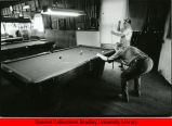 Two men playing pool