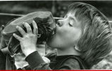 Boy drinking from canteen