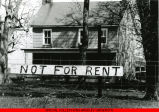 "Abandoned house with ""Not For Rent"" sign in front"