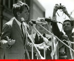 Bobby Kennedy gesturing while giving a speech