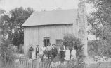 Group outside a farm house.