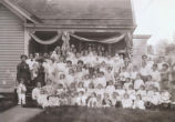 Large group portrait outside house