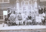 Group of costumed men and women