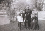 Portait of man, child, and older women