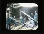Carpenters working, with a tattooed man
