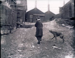 Woman and dog, rear of State Street buildings