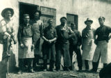 Men Outside Blacksmith Shop