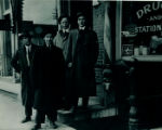 Four young men posting in front of Stewart Drug Store on State