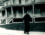 Lucille Meurer Doyle walks in front of Gaines mansion, 10th and Hamilton