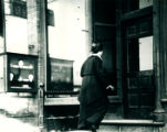 Woman entering Post Office on State Street