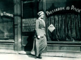 Woman passing by billiards parlor