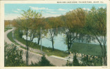 Road and Lake Scene, Pilcher Park, Joliet, Ill.