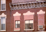 Bricked-in windows in business building at 931 S. State Street, Lockport (Ill.)