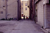 Boys playing, alley between 9th and 10th Street, Lockport, IL