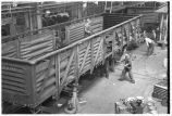 Working on railroad car rebuilding line