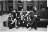 Woman, boys, and elderly man in waiting room, Union Station, Chicago, May 1948