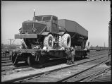 Measuring loaded freight car to see if within limits-Clyde freight yards