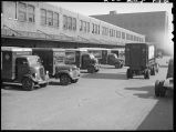 Trucks at loading dock, Railway Express terminal on CB&Q tracks, Chicago, May 1948