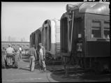 Workers repairing passenger coaches, 14th Street passenger yards, Chicago, May 1948