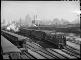 Trains against Chicago skyline, 14th Street passenger yards, Chicago, May 1948