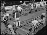 Workers maintenancing railroad tracks, 14th Street passenger yards, Chicago, May 1948