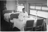 Minn. 1. Dining car waiter folding napkins