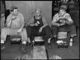 Workmen eating lunch-Diesel repair shop-W. Burlington, Iowa