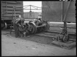 Replacing trucks on box car-Car repair tracks-Galesburg, Ill.
