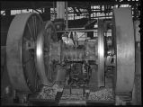 Turning driving tires in 90 inch driving wheel lathe. Locomotive repair shops-W. Burlington, Iowa