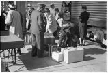 Passengers claiming luggage at station, Burlington, Iowa