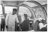 Minnesota-Porter giving information to passenger on Vista Dome car of morning Zephyr en route to...