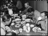 Members of extra gangs nos. 37 & 38 eating noon-day meal in mess car at Nodaway, Iowa
