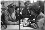 Clerk assisting serviceman at information booth, Union Station, Chicago, May 1948