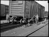 Jacking up box car before removing trucks-Havelock, Nebraska