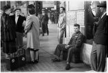 Serviceman and others waiting to board train, Union Station, Chicago, May 1948