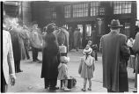 Woman with girls in crowd waiting to board train, Union Station, Chicago, May 1948