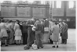 Servicemen and others in concourse by information booth, Union Station, Chicago, May 1948