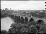 Burlington Zephyr crossing stone arch bridge at Minneapolis