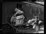 Bonneville-Postmistress gets mail upon arrival of northbound train
