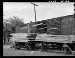 Unloading car of lumber-Minneapolis
