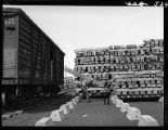 Unloading ties from boxcar at tie preservative plant