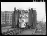 Workers cleaning Zephyr diesel engine car, 14th Street passenger yards, Chicago, May 1948
