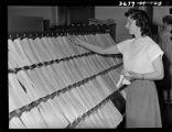 Woman clerk filing slips that show location of freight cars, Burlington Railroad office, Chicago, June
