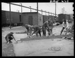 Workers laying concrete, 14th Street passenger yards, Chicago, May 1948