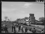 Extra gangs stop working as passenger train goes through, Nodaway, Iowa