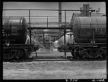 Tank cars being loaded with chemicals and part of Consolidated Chemical Industries, Inc. plant,...