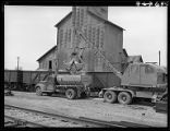 Loading agricultural limestone into truck, Nodaway, Iowa