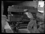 Wheeling freshly pressed brick to drying ovens at Summit Pressed Brick & Tile Co.-Pueblo