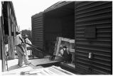 Loading freight car with cotton gin machinery at plant of the Murray Co., Dallas