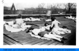 National College of Education students, sunbathing.